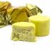 Фото конфет Hajabdollah халва царская в шафрановой глазури со вкусом шафрана и фисташек, крупный план