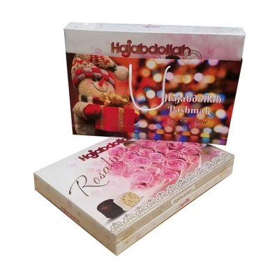 Фото подарочной новогодней 2019 упаковки конфет Hajabdollah из царской халвы в  белой и шоколадной глазури Розы Розовые вид спереди